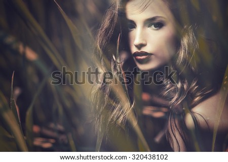 beautiful long hair brunette woman portrait, double exposure with blades of grass - stock photo