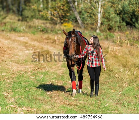 beautiful long hair young woman with horse outdoor