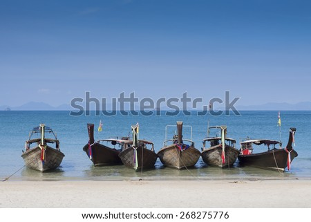 Beautiful long tails boats on blue andaman sea background near Krabi in Thailand - stock photo