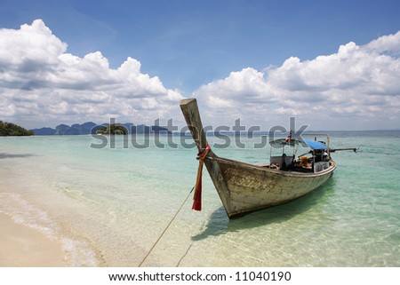 beautiful longtail boat on the sand seashore