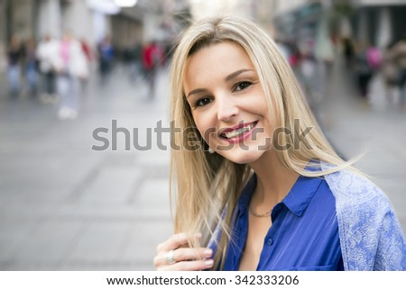 Beautiful Lovable Young Woman Portrait, Smiling at Camera, city smile - stock photo