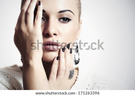 Beautiful Lovely Woman with Jewelry. Sad Beauty Girl Accessories. Manicure - stock photo
