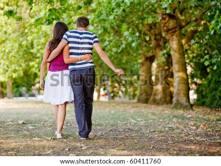 Beautiful loving couple going for a walk outdoors - stock photo