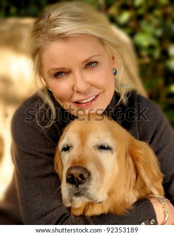 Beautiful Loving Image of a Woman and her dog - stock photo