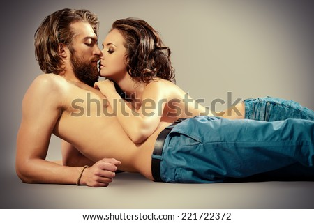 Beautiful loving young people kissing. Passion. Love concept.    - stock photo