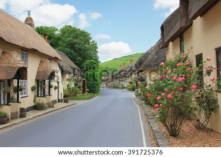 beautiful lulworth village with thatched houses and flower decoration, dorset uk - stock photo