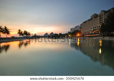 Beautiful luxury apartment at seaside during sunset moment.  - stock photo