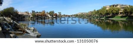 Beautiful luxury homes on a desert lake - stock photo