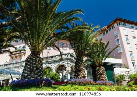 Beautiful Luxury Hotel and Palm Trees in Optija, Croatia - stock photo