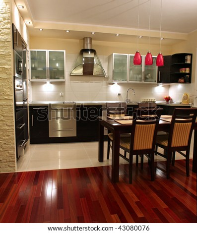 Beautiful, luxury modern kitchen with exotic wood on the floor