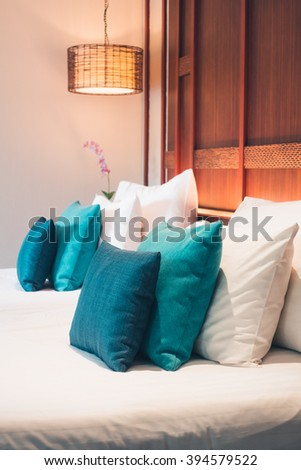 Beautiful luxury pillow on bed decoration in bedroom interior - Vintage Light Filter