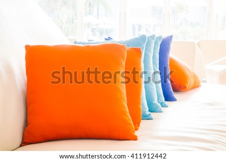 Beautiful luxury pillow on sofa decoration in livingroom interior for background - Vintage Filter - stock photo