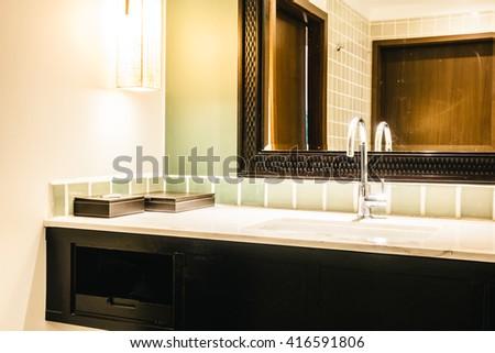 Beautiful luxury sink decoration in bathroom interior - Vintage Light Filter - stock photo
