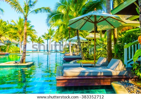 Beautiful luxury swimming pool in hotel pool resort - Boost up color Processing - stock photo