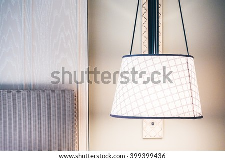 Beautiful luxury white pillow on bed and light lamp on wall decoration in bedroom interior - Vintage Light Filter