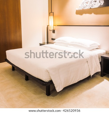 Pillows mattresses orange light sleep stock photo for Beautiful bed decoration