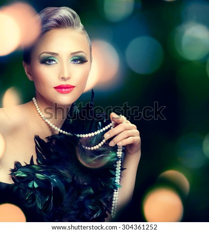 Beautiful Luxury Woman portrait. Beauty Lady with expensive accessories - pearls necklace over dark blurred background. Holiday dress and make up - stock photo