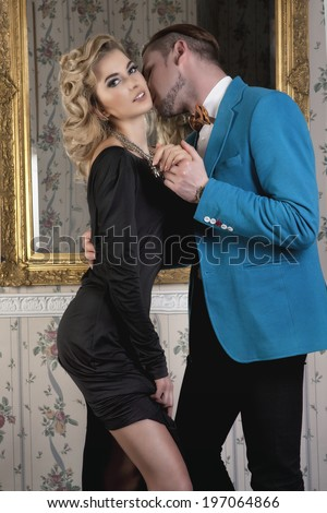 Beautiful madam and gentleman in the luxury apartment, hotel room - stock photo