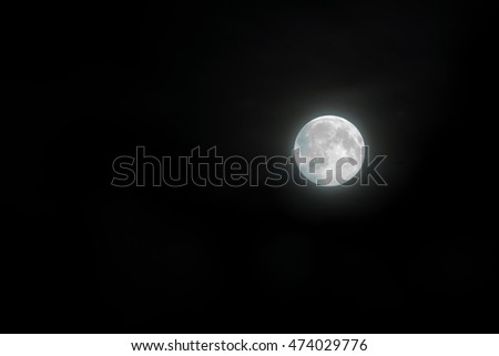 Beautiful magic night sky with clouds and fullmoon