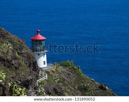 Beautiful Makapuu lighthouse on cliff in Oahu, Hawaii - stock photo