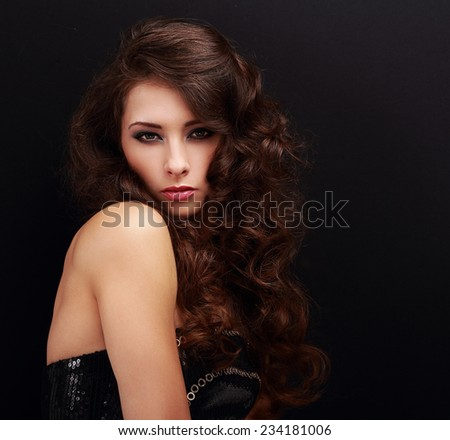 Beautiful makeup woman with curly hairstyle on black background