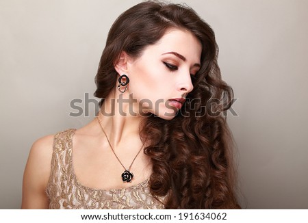 Beautiful makeup woman with long bright curly hair. Female profile - stock photo