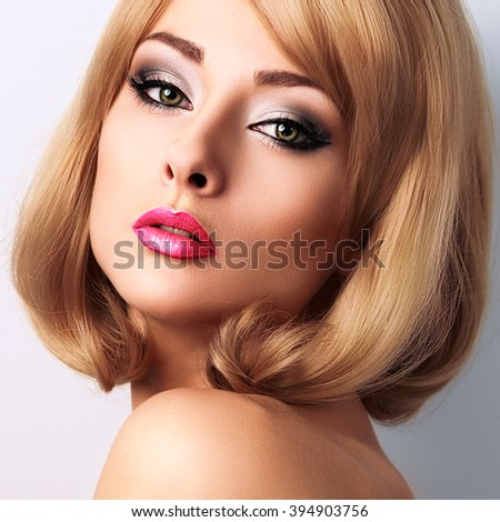 Beautiful makeup woman with long lashes and pink lipstick. Short blond hairstyle. Closeup bright portrait - stock photo