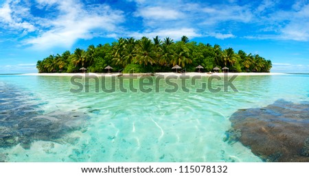 Beautiful Maldivian atoll with white beach seen from the sea.Panorama - stock photo