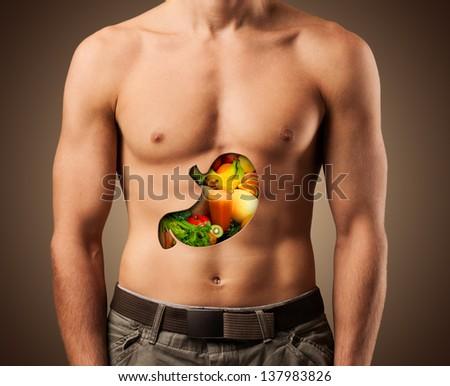 Beautiful male torso. Healthy food.. Fitness - stock photo