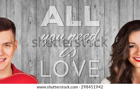 Beautiful man and woman on gray background with text all you need is love - stock photo
