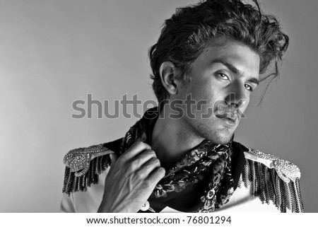 Beautiful man in exclusive design clothes on manners old-slavic. Black-white Photo. - stock photo
