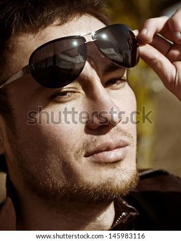Beautiful man in fashionable sunglasses.  - stock photo