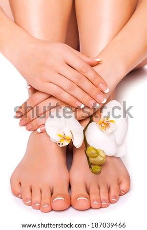 beautiful manicure and pedicure on the white - stock photo
