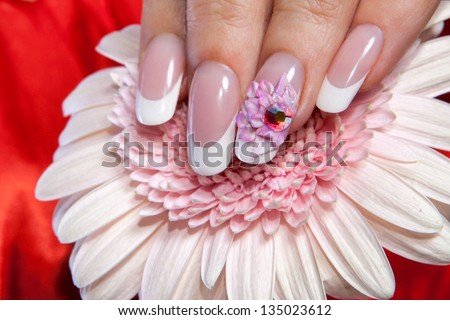 Beautiful manicure with flower design - stock photo