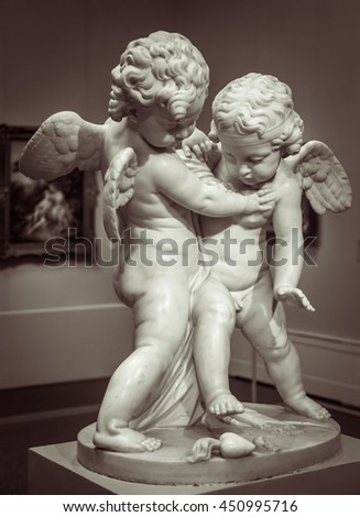 Beautiful marble statue of two angels.