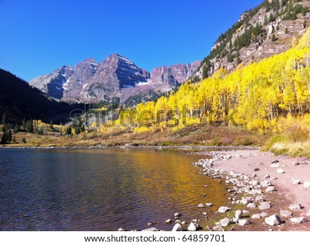 Beautiful Maroon Bells with golden aspens in the Rocky Mountains of Colorado at dawn