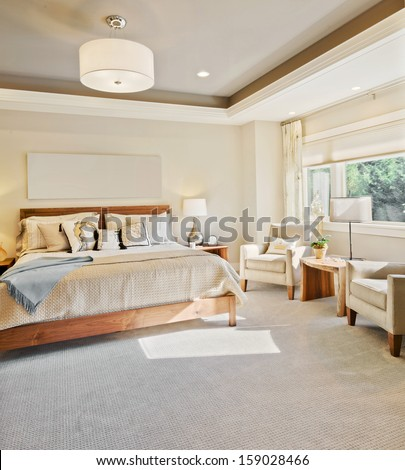 Beautiful Master Bedroom in Luxury Home - stock photo