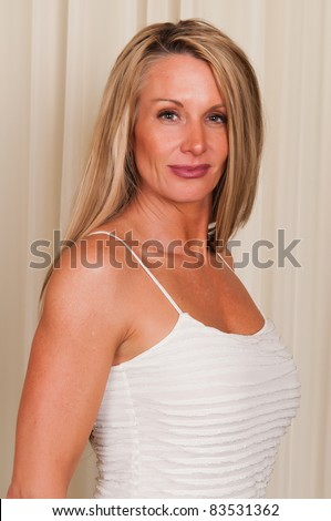 Beautiful mature blonde in a white blouse