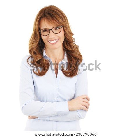Beautiful mature business woman standing against white background.