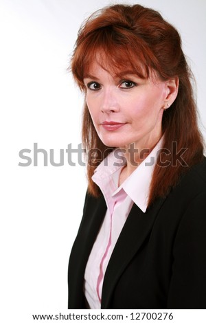 beautiful mature business woman with red hair - stock photo