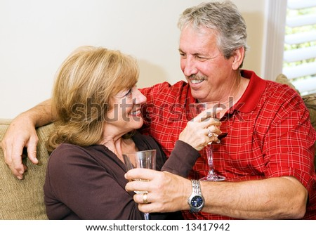 Beautiful mature couple relaxing together with a glass of wine.