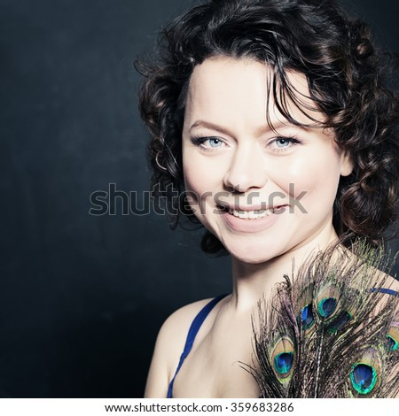 Beautiful Mature Woman Fashion Brunette with Peacock Feathers - stock photo