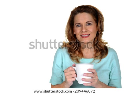 Beautiful Mature Woman holding a White Coffee Cup - stock photo