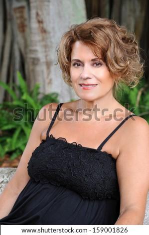 Beautiful Mature Woman in a Black Dress - stock photo