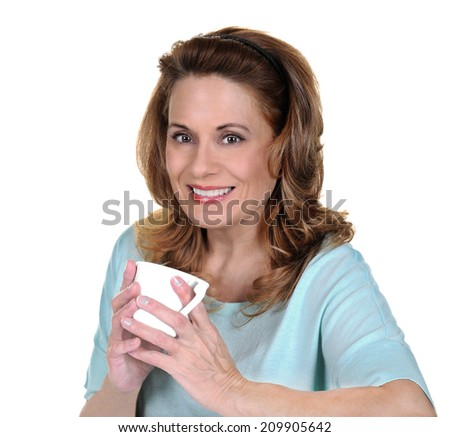 Beautiful Mature Woman in a Sweater holding a White Coffee Cup