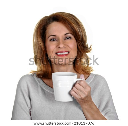 Beautiful Mature Woman in a Sweater holding a White Coffee Cup - stock photo