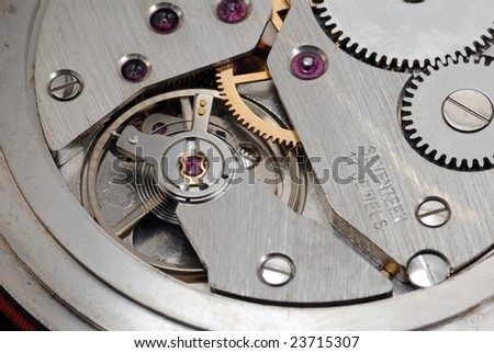 Beautiful mechanism of old watch. close up - stock photo