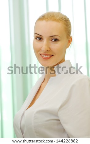 Beautiful medical doctor woman - stock photo