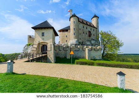 Beautiful medieval castle on sunny day with white clouds on blue sky, Bobolice, Poland