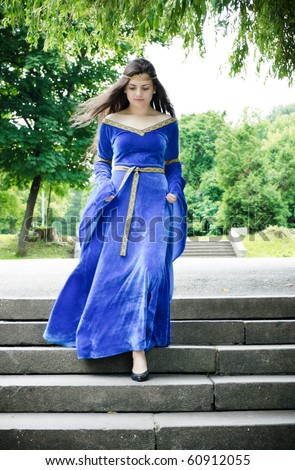 beautiful medieval woman down the stairs - stock photo